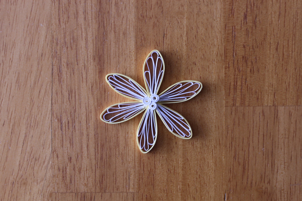 yellow quilling flower